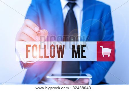 Word writing text Follow Me. Business concept for Inviting a demonstrating or group to obey your prefered leadership Businessman pointing with pen in empty copy space. poster