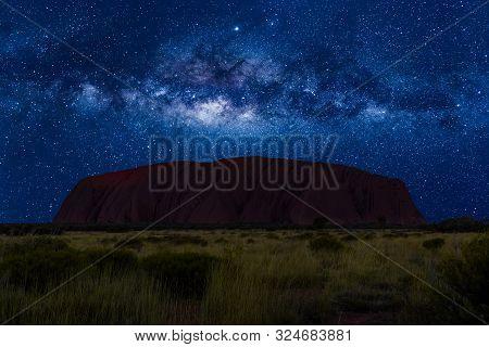 Uluru, Northern Territory, Australia - Aug 22, 2019: Spectacular Uluru By Night With Milky Way, Star