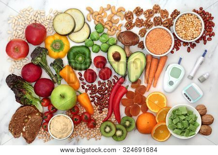 Low glycemic food for diabetics with blood sugar testing kit & pedometer. Health food below 55 on the GI index & high in vitamins, minerals, anthocyanins, antioxidants, smart carbs & omega 3. Flat lay