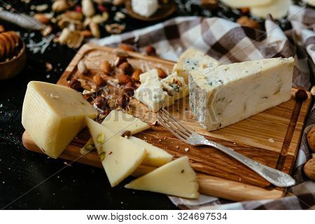 Cheeseboard. Delicious Blue Cheese On The Board. Blue Cheese Gorgonzola With Nuts