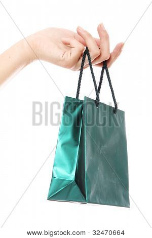 Small shopping bag in hand over white background