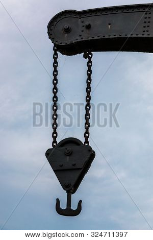 Old Crane With Chains Made Of Steel