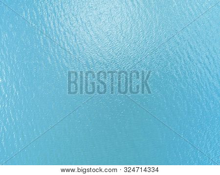 Aerial View Of A Crystal Clear Sea Water Texture. View From Above Natural Blue Background. Turquoise