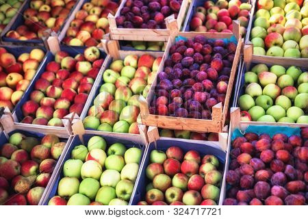 Fresh Farmers Apples And Plums At Local Outdoor Market. Healthy Food Background