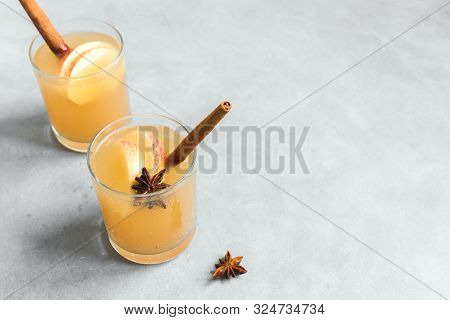 Spicy Apple Cider Drink. Seasonal Homemade Apple Cider On White Background, Copy Space.