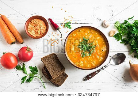 Red Lentil Soup On White Wooden Background, Top View, Copy Space. Traditional Turkish Or Arabic Lent