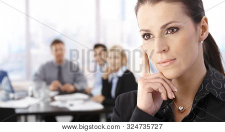 Businesswoman thinking on business meeting, looking away.