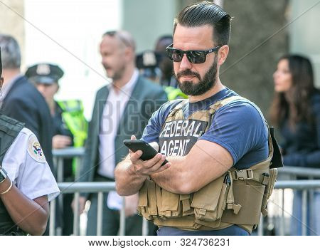 New York City, 9/27/2019: Federal Agent Is Checking His Phone At A Street Closure In Manhattan.
