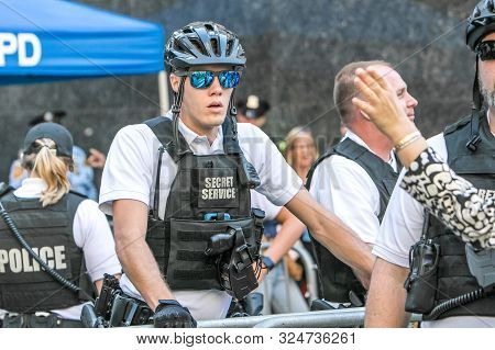 New York City, 9/27/2019: Young Secret Service Agent Is Helping Man A Street Closure During Un Gener