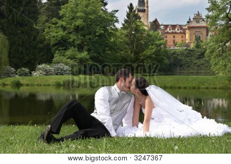 Bridegroom And Bride On The Wedding In Park