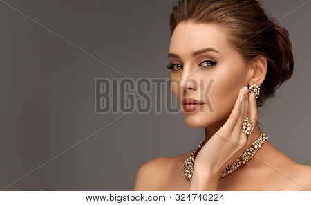 Beautiful Girl With Set Jewelry .   Woman In A Necklace With A Ring, Earrings And A Bracelet. Beauty