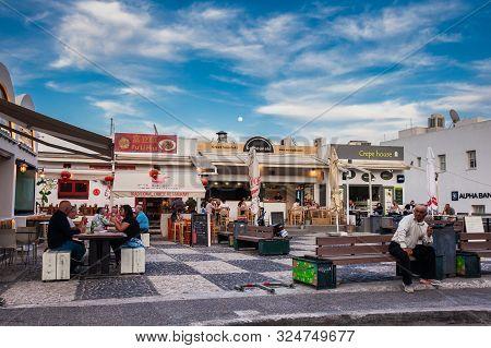 Santorini, Greece - April, 2018: Tourists And Locals At A Food Court At Fira City In Santorini Islan