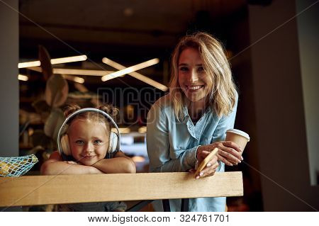 Gladsome Mother And Daughter In Cafe Stock Photo
