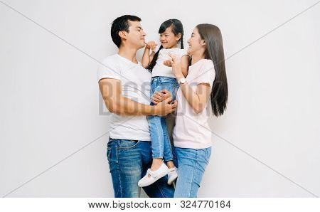 Portrait Of Happy Asian Family With Daughter, Teasing Dad And Mommy. On White Background. Weekend Ac