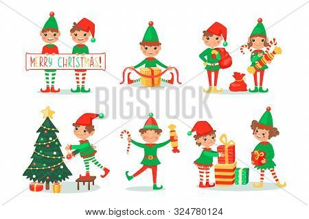 Smiling Elves Packing Gifts. Decorating Christmas Tree For Celebration. Happy Children In New Year F