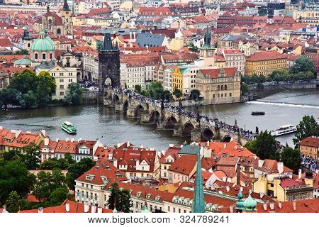 Prague Panorama With Charles Bridge And Vltava River.