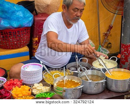 Hoi An, Vietnam - 28 Jul 2019: Local Eatery With Food Seller And Soup Bowl. Vietnamese Street Food.