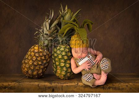 Cute composite image with fresh pineapples and a newborn baby in felted pineapple hat