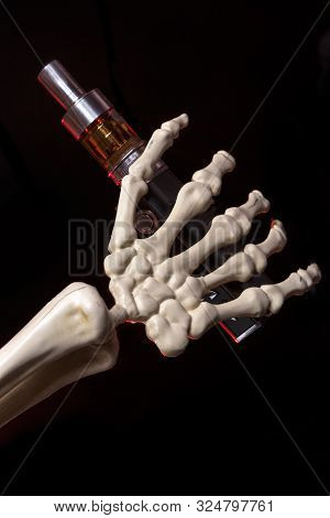 Skeleton Hand Holding An Ecigarette With Ejuice In It