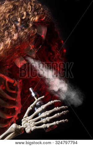 Female Skeleton Vaping Clouds Of Vapor With An Ecigarette