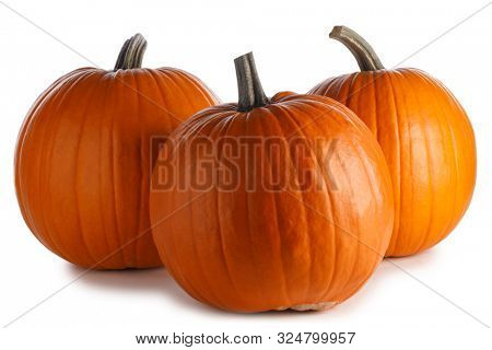 Three perfect pumpkins isolated on white background