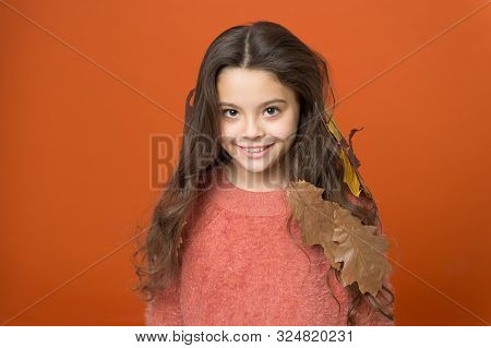 Leave Haircare To Professionals. Happy Child Wear Autumn Leaves In Long Hair. Autumn Haircare. Hairc