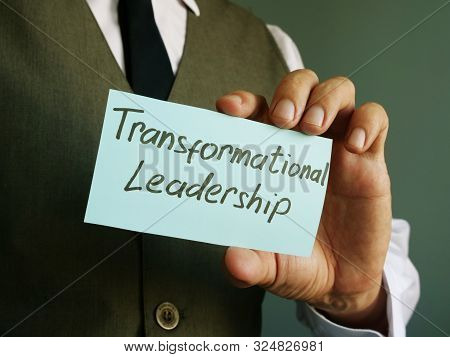 Transformational Leadership Sign On A Black Page.