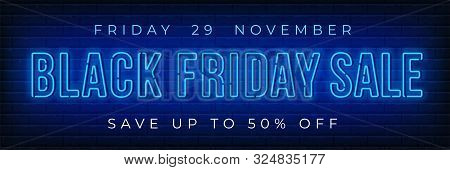 Advertisement Of Black Friday Sale. Bright And Enticing Design With Luminous Neon Letters On Brick W