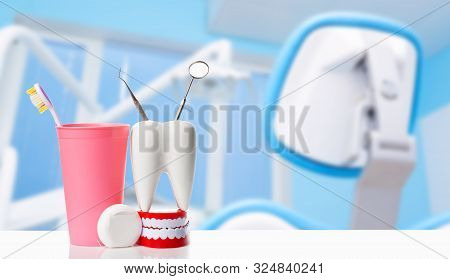Dental Mirror And Dental Explorer Instrument In White Tooth Model, Human Jaw And Dental Floss Near T