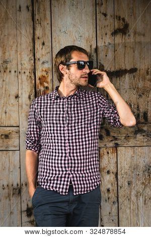 Man Speaking On The Phone. Man Speaking On The Cell Phone. Portrait Of Man Speaking On The Cell Phon