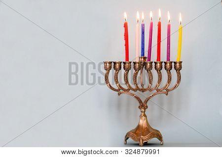 Sixth Day Of Hanukkah With Burning Hanukkah Colorful Candles In Menorah Traditional Candelabra .chan