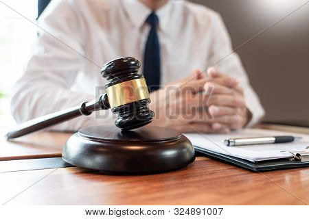 Lawyer Or Judge Business Man Working With Paperwork Agreement Contract And Gavel In Courtroom, Justi