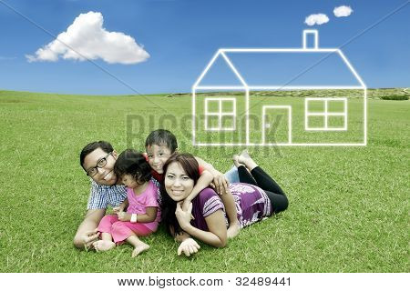 Happy Family With Dream House
