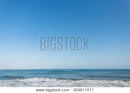 Perfect Clear Blue Sky And Sea With Waves. Sunny Day. Ocean Horizon. Nature Composition.