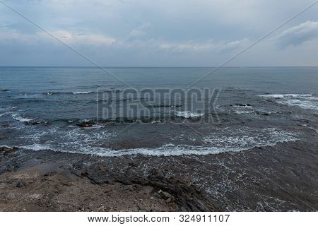 Sea With Waves And Rocks With Sky And Clouds. Seascape In The Evening. Natural Composition. Spain.