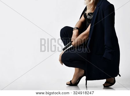 Closeup Portrait In Profile Of Glamorous Woman Blonde In Velvet Bralet, Blue Jacket And Pants, High
