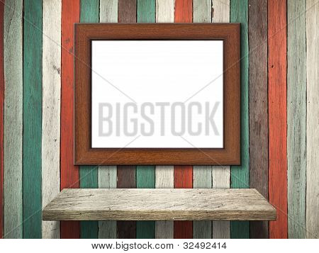 Picture Frame On Old Wood Wall And Shelf