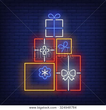 Pile Of Gifts Neon Sign. Present Boxes, Carton Wrap, Ribbon, Bow. Vector Illustration In Neon Style