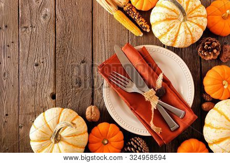Autumn Harvest Or Thanksgiving Table Setting With Silverware, Orange Napkin, Pumpkins And Decor. Top