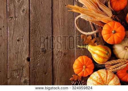 Fall Side Border Of Pumpkins, Gourds And Fall Decor With Harvest Basket On A Rustic Wood Background