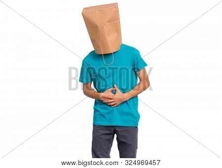 Portrait of teen boy with paper bag over head, with stomachache, isolated on white background. Child with hands on stomach. Diarrhea or gastroenteritis health problem.