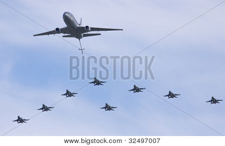 Dutch F-16 squadron flying in formation with a KDC-10 tanker
