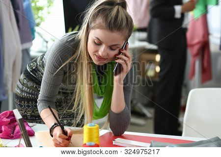 Fashion Clothes To Bespoke Designer Talking Phone. Busy Young Woman With Smartphone. Caucasian Seams
