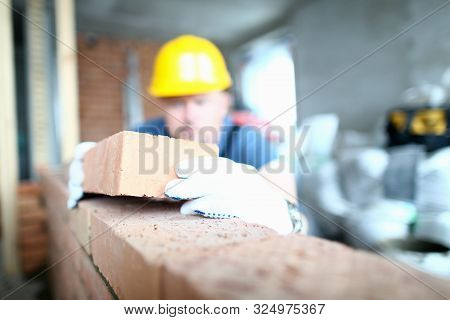 Focus On Hardworking Constructor Laying Red Bricks On Concrete Wall With Strict Accuracy. Prudent Ma
