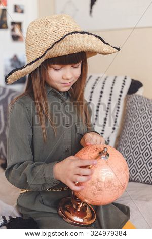 Portrait Of Lovely Girl Exploring Globe In Dreams About Travel