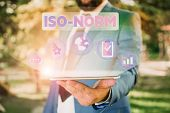 Text sign showing Iso Norm. Conceptual photo An accepted standard or a way of doing things most showing agreed Male human wear formal work suit presenting presentation using smart device. poster