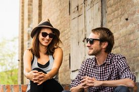 Couple In Love Smiling Outdoors. Happy People Lifestyle. Happy Hipster Couple Smiling Outdoor. Trave