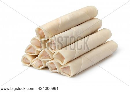 Heap of raw fresh made Vietnamese egg rolls isolated on white background