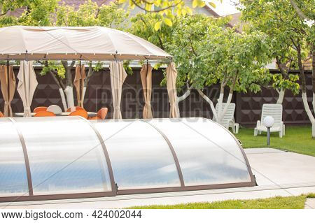 Outdoor Swimming Pool With A Shelter. Cover For The Pool