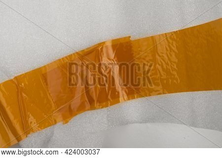 Bright Wrinkled Adhesive Tape On The Plastic Surface